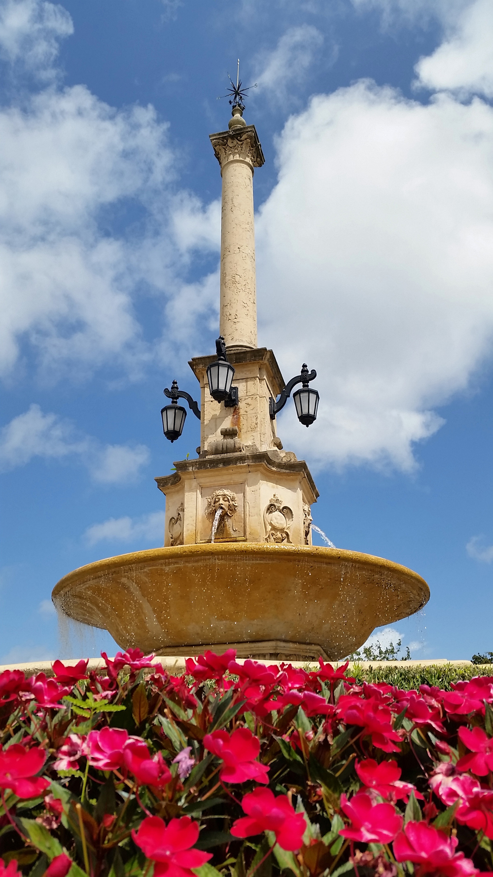 Coral Gables De Soto Fountain. Adorned with colorful flowers and small shrubs, the De Soto Fountain really is a simple yet elegant backdrop to your photos.