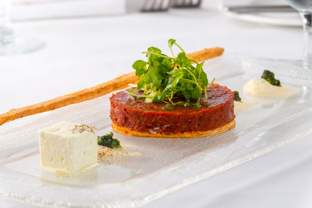 Pascal' on Ponce serves this tomato tatin with sheep milk cheese, mustard , creme fraiche, and garden salad.