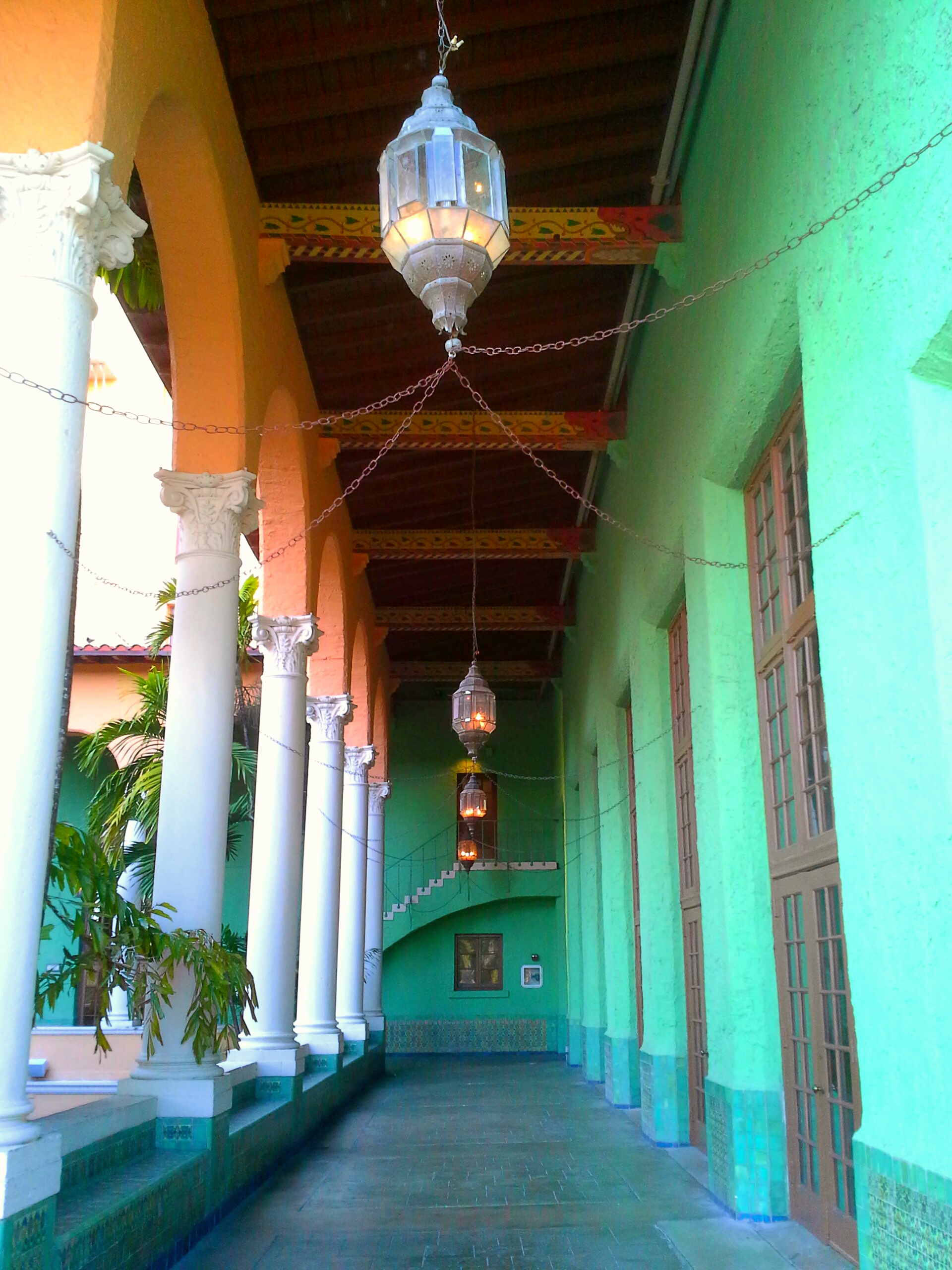 The Biltmore Hotel has an upper courtyard with a long corridor with bright green walls. This is a famous spot for engagement photos