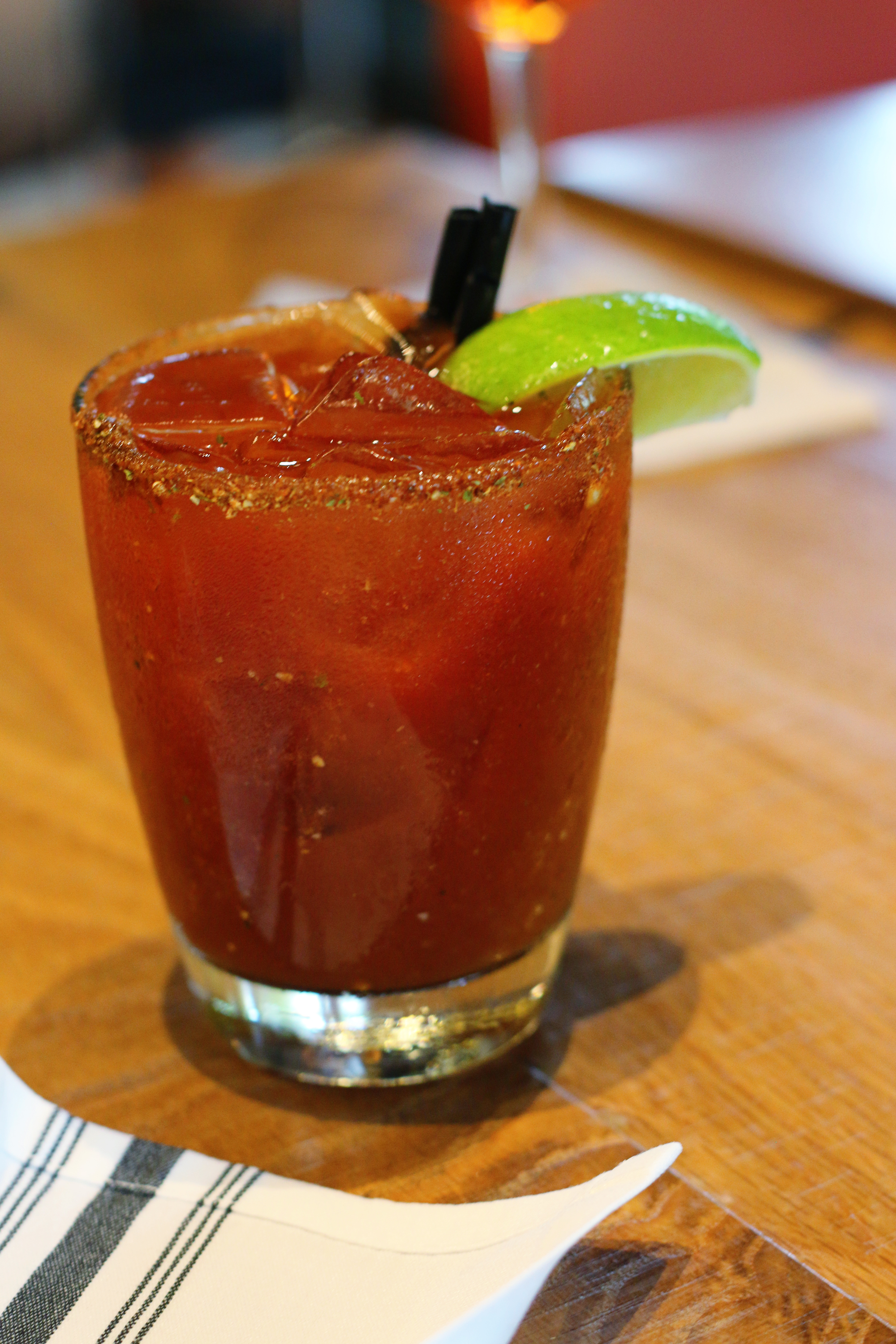 Miami restaurant, Glass & Vine, serves bloody marys with house rub on the rim. A must for bloofy mary lovers! Click to read more or pin and save for later! Coral Gables | Coconut Grove | Florida