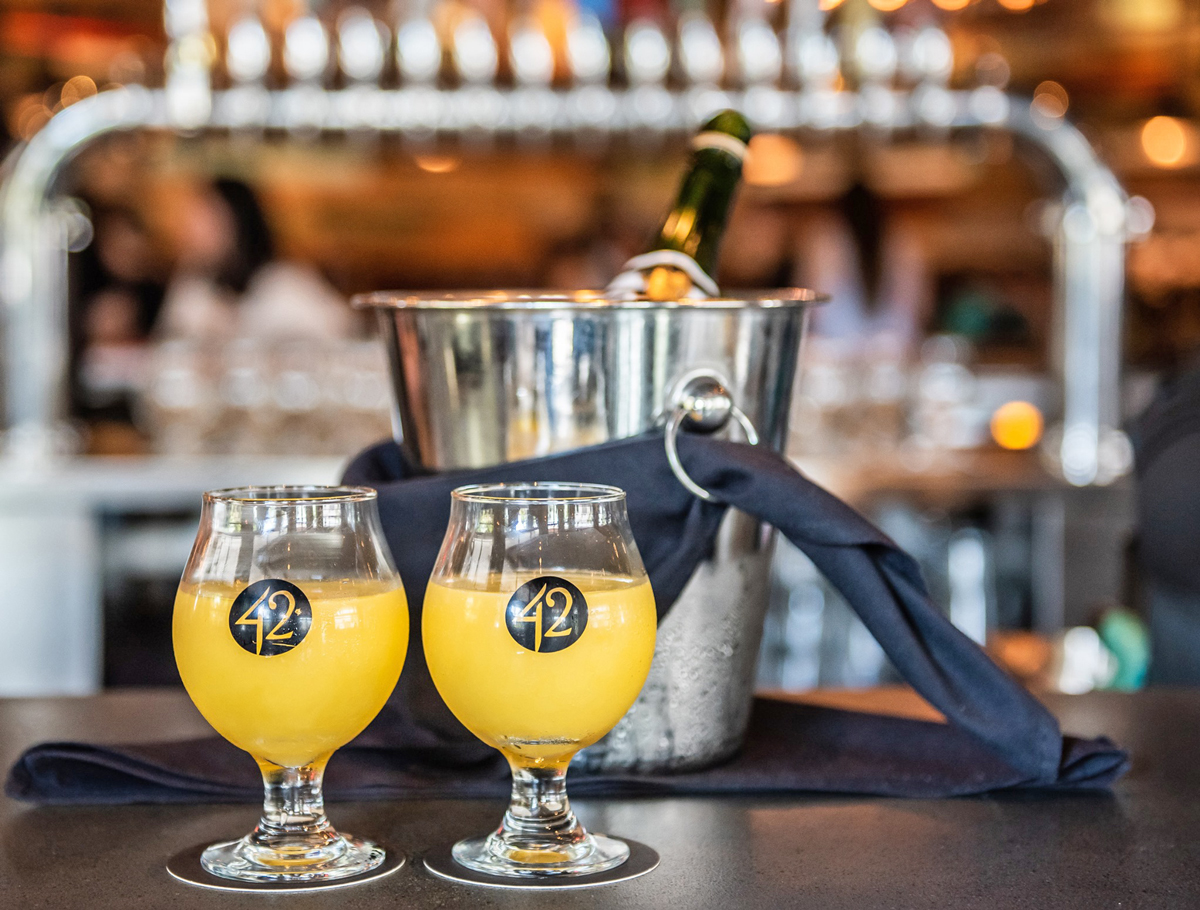 Best Miami Party Brunch Tap 42 in Coral Gables with Bottomless mimosas and a live DJ