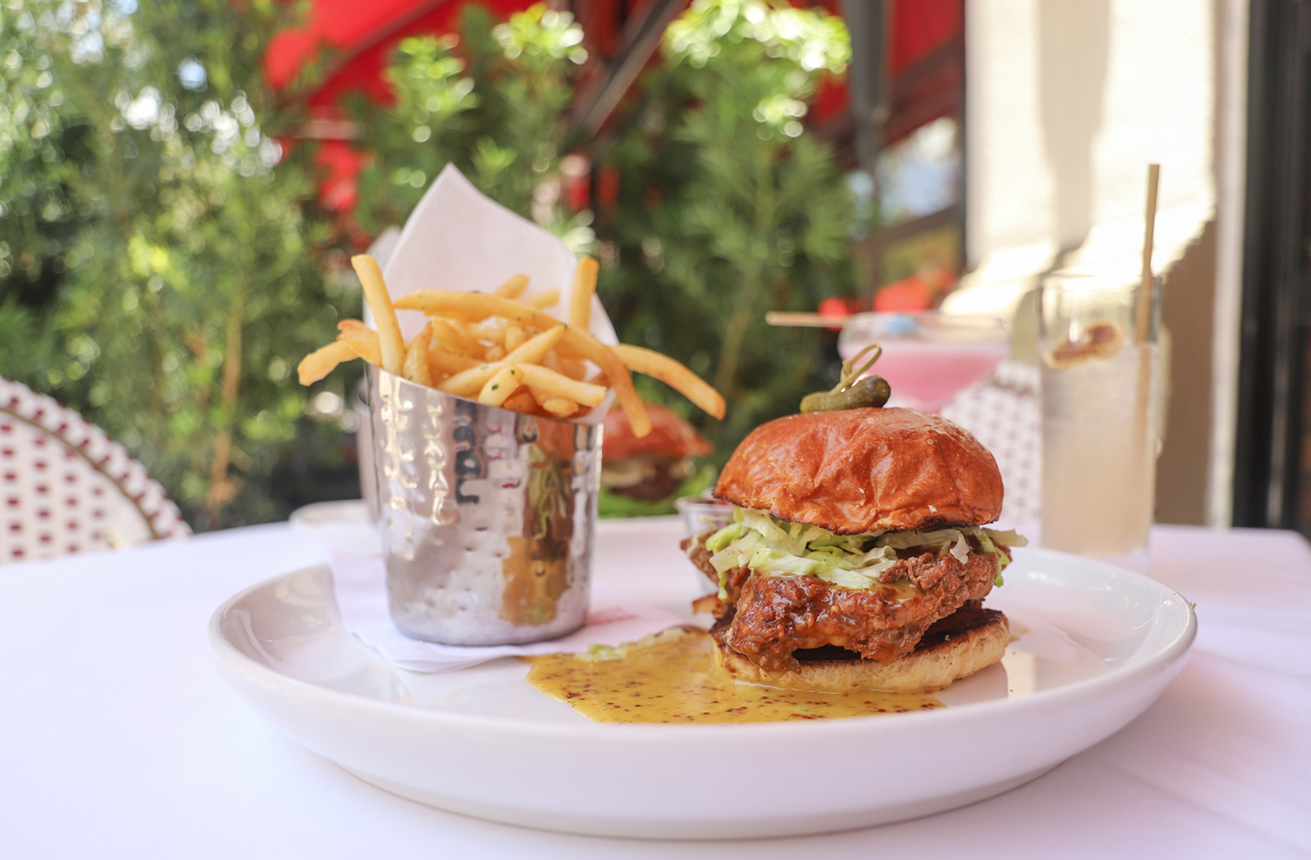 The Gramercy New Restaurant in Coral Gables crispy fried chicken sandwich with fries