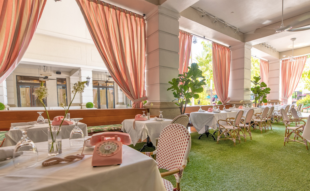 The Gramercy New Restaurant in Coral Gables outdoor dining with pink phones and curtains